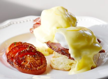 Eggs Benedict and grilled tomatoes